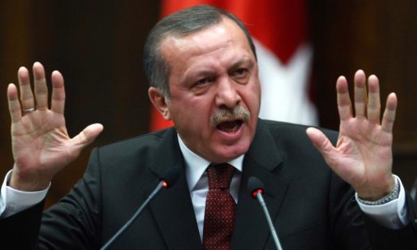 أردوغان ينتقد صمت أوباما إزاء جريمة قتل 3 طلاب مسلمين في الولايات المتحدة.